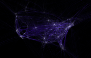 A black background with bluish lines tracing the routes of commercial airline traffic: there are so many routes that the shape of the USA is clearly visible. Major cities appear as bright spots of connecting lines.