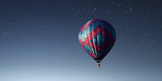 Hot air balloon in the night sky