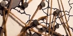 map with thumbtacks and string